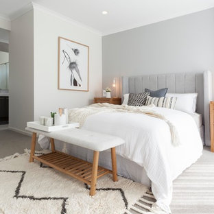 Photo of a scandinavian master bedroom in Melbourne with grey walls, carpet and grey floor.