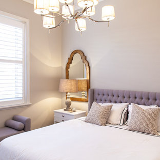 Traditional bedroom in Melbourne with beige walls.