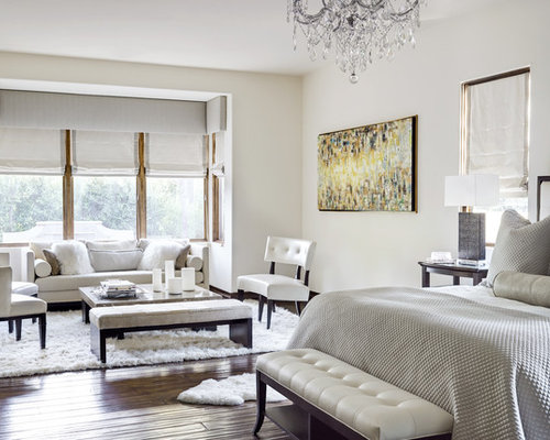Inspiration For A Mediterranean Master Bedroom Remodel In Phoenix With  White Walls And Dark Wood Floors