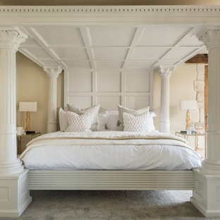 Inspiration for a mid-sized transitional carpeted and gray floor bedroom remodel in Gloucestershire with beige walls