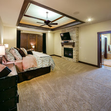 Rustic Bedroom by Starr Homes