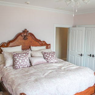 Large cottage chic master ceramic floor bedroom photo in New York with beige walls