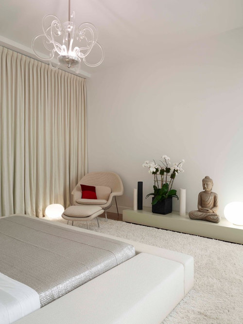 Trendy carpeted bedroom photo in New York with white walls. Zen Bedroom   Houzz