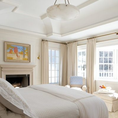 Inspiration for a timeless bedroom remodel in New York with a standard fireplace