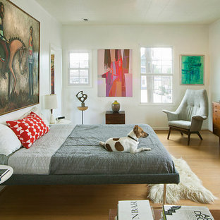 Inspiration for a midcentury modern light wood floor bedroom remodel in Houston with white walls