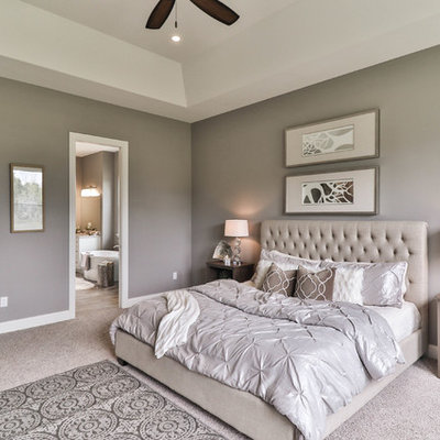 Large transitional master carpeted and gray floor bedroom photo in St Louis with beige walls and no fireplace