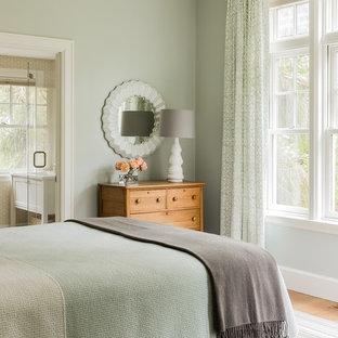 Bedroom - mid-sized transitional guest medium tone wood floor bedroom idea in Boston with green walls