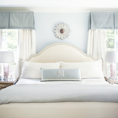 Inspiration for a transitional bedroom remodel in Raleigh with blue walls