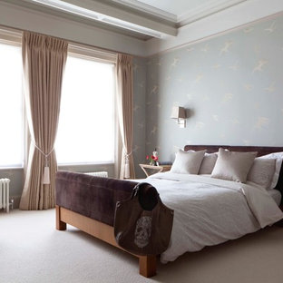 Example of a classic master carpeted bedroom design in London with blue walls