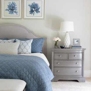 Inspiration for a large beach style master carpeted and beige floor bedroom remodel in Houston with gray walls