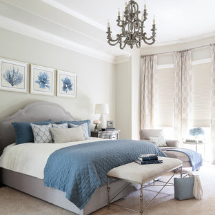 Inspiration for a large nautical master bedroom in Houston with grey walls, carpet and beige floors.