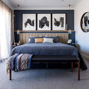 Inspiration for a large contemporary master bedroom in Sydney with white walls, carpet and grey floor.