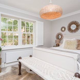 Design ideas for a medium sized eclectic bedroom in London with grey walls, carpet and grey floors.