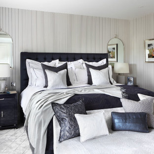 Mid-sized elegant master bedroom photo in London with multicolored walls
