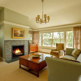 Imagen de dormitorio principal, de estilo de casa de campo, grande, con paredes verdes, moqueta, chimenea tradicional y marco de chimenea de baldosas y/o azulejos