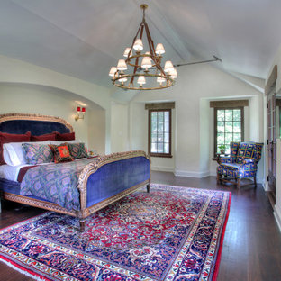 Example of a farmhouse dark wood floor bedroom design in New York with white walls