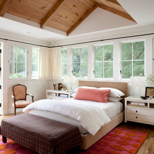 Example of a cottage master medium tone wood floor bedroom design in Other with white walls