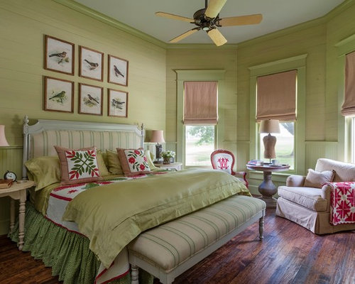 Example Of A Country Dark Wood Floor Bedroom Design In Houston With Green  Walls