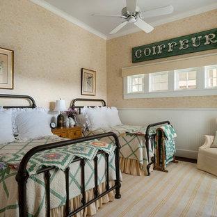 Country dark wood floor bedroom photo in Houston with beige walls