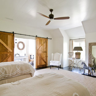 Example of a cottage guest dark wood floor bedroom design in Atlanta with white walls