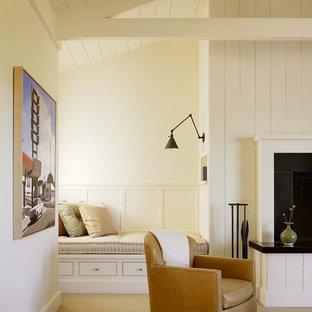 Imagen de dormitorio principal, de estilo de casa de campo, de tamaño medio, con paredes blancas, moqueta, chimenea tradicional, marco de chimenea de baldosas y/o azulejos y suelo beige