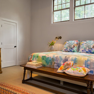 Large minimalist master beige floor and carpeted bedroom photo in Boston with white walls