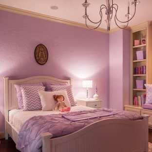 Photo of a mid-sized traditional bedroom in Houston with purple walls and medium hardwood floors.