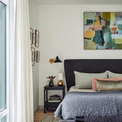 Bedroom - contemporary medium tone wood floor and brown floor bedroom idea in Boston with white walls