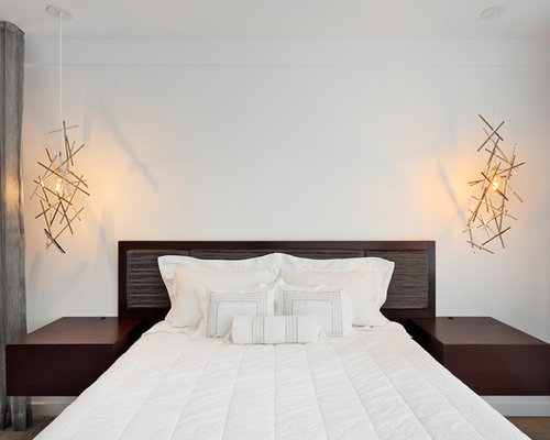 Mid Sized Danish Master Light Wood Floor Bedroom Photo In New York With  White Walls