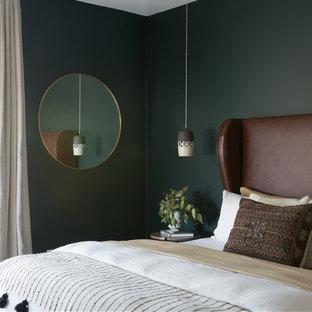 Inspiration for a large scandinavian master light wood floor and beige floor bedroom remodel in San Francisco with green walls
