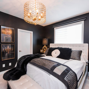 This is an example of a contemporary master bedroom in Other with black walls and carpet.