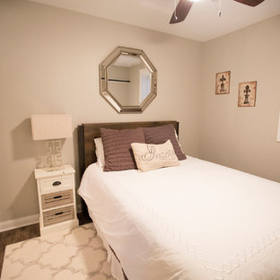 Small transitional guest bedroom in Chicago with vinyl floors, beige walls, no fireplace and brown floor.