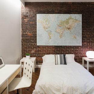 Imagen de dormitorio actual con paredes blancas