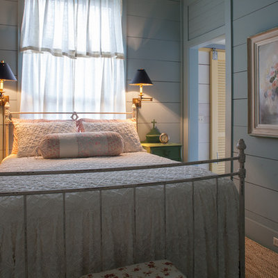 Example of a cottage chic bedroom design in Miami with gray walls