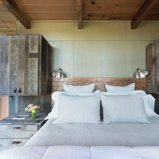 Design ideas for a small country loft-style bedroom in San Francisco with medium hardwood floors.