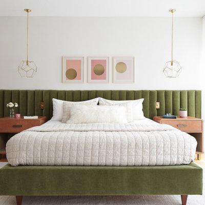 Example of a large trendy master light wood floor and beige floor bedroom design in Philadelphia with white walls
