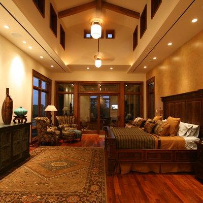 Example of an eclectic dark wood floor bedroom design in Dallas with beige walls