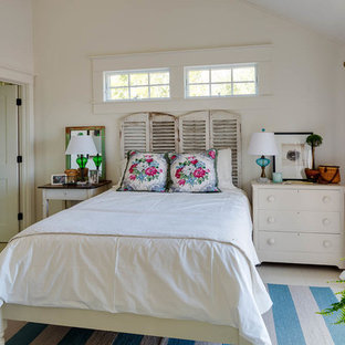Example of a mid-sized coastal guest ceramic floor bedroom design in Boston with white walls and no fireplace