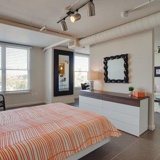 Diseño de dormitorio principal, actual, pequeño, sin chimenea, con paredes blancas, suelo de baldosas de porcelana y suelo gris