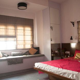 Diseño de dormitorio principal, asiático, de tamaño medio, sin chimenea, con paredes blancas y suelo de pizarra