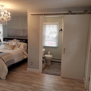 Floating Laminate Floor in Master Bedroom & Floating  Vinyl Floor in Bathroom
