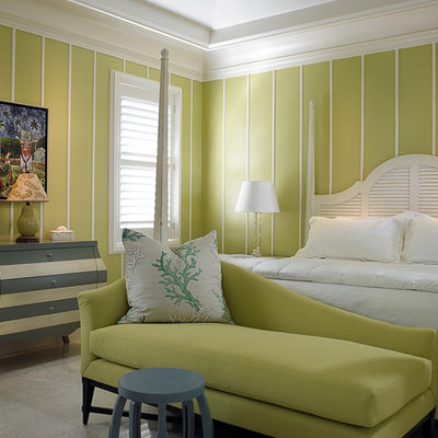 Example of an island style bedroom design in Toronto with green walls