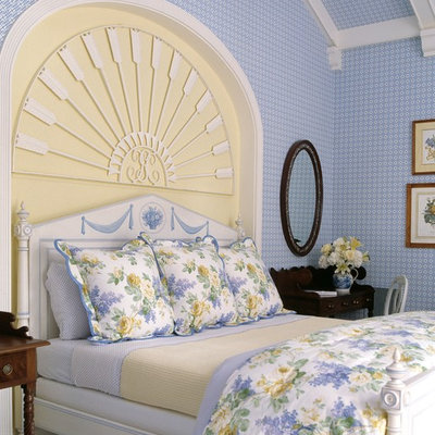 Inspiration for a tropical bedroom remodel in Miami with blue walls