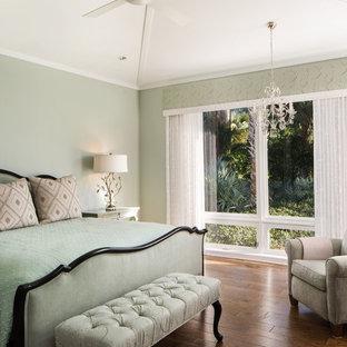 Bedroom - mid-sized transitional master medium tone wood floor bedroom idea in Miami with green walls