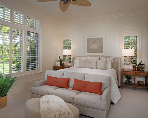 couch in bedroom. Mid sized island style master carpeted bedroom photo in Miami with white  walls Bedroom Couch Houzz
