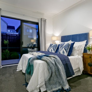 Transitional carpeted and green floor bedroom photo in Auckland with white walls
