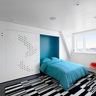 Inspiration for a modern bedroom in San Francisco with blue walls and dark hardwood flooring.