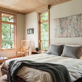 Example of a mid-sized mountain style master light wood floor and brown floor bedroom design in Atlanta with beige walls and no fireplace