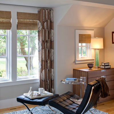 Example of a large trendy master light wood floor and brown floor bedroom design in Boston with gray walls