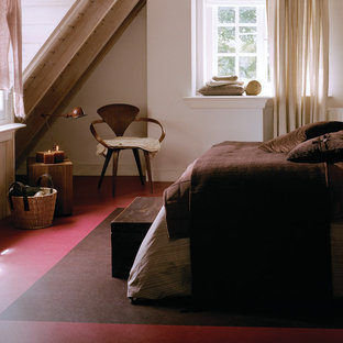 This is an example of a mid-sized country loft-style bedroom in Chicago with white walls, linoleum floors and no fireplace.